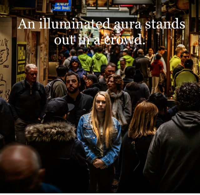 An illuminated aura stands out in a crowd.